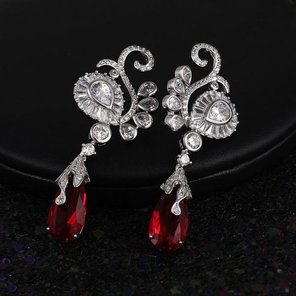 This bold/brilliant/stunning  red CZ diamond earring is sure to get you noticed.